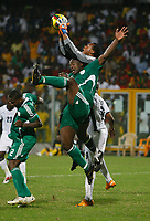 Photo: Steve Bond/Richard Lane Photography.<br />Ghana v Nigeria. Africa Cup of Nations. 03/02/2008. Keeper Austine Ejide gathers the ball. Daniel Shittu (front) also goes for the cross while Junior Agogo (back) makes a nuisance of himself