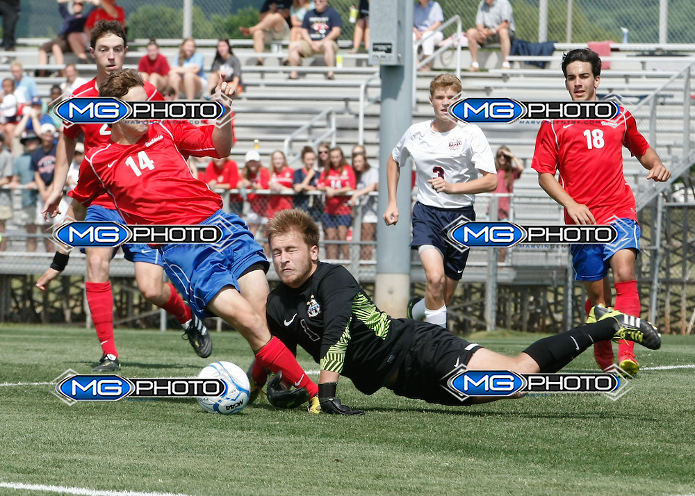 May 10, 2014; Huntsville, AL, USA;  Oak Mountain keeper Brad Louis (1) blocks the shot of Vestavia Jack McDaniel (14) during the Championship game at John Hunt Soccer Complex. Mandatory Credit: Marvin Gentry