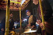 ISTANBUL, TURKEY - NOVEMBER 24, 2003: The end of the ramadan is celebrated with the yearly Sugar feast. --Street vendors in traditional Turkish clothes--