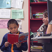 Ramara Begay helps her student Tyrese Jones with his reading skills Wednesday at Canyon de Chelly Elementary School in Chinle.