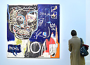 © Licensed to London News Pictures. 31/01/2013. London, UK A woman looks at Jean-Michel Basquiat's Untitled (Pecho/Oreja) estimated to raise 7-9Million GBP. Preview of highlights from Sotheby's forthcoming February sales of Impressionist & Modern Art and Contemporary Art in London, including works by Picasso, Bacon, Monet, Richter and Miró. Photo credit : Stephen Simpson/LNP