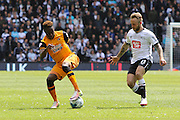 Hull midfielder Moses Odubajo on the ball during the Sky Bet Championship play-off first leg match between Derby County and Hull City at the iPro Stadium, Derby, England on 14 May 2016. Photo by Aaron  Lupton.