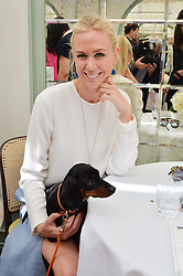 SOPHIE CROSS and her dog Luna at a party hosted by Lulu Guinness and Daphne's to launch Lulu's Designer Dog Bowl and to mark Daphne's allowing dogs through it's doors, held at Daphne's, Draycott Avenue, London on 28th June 2016.