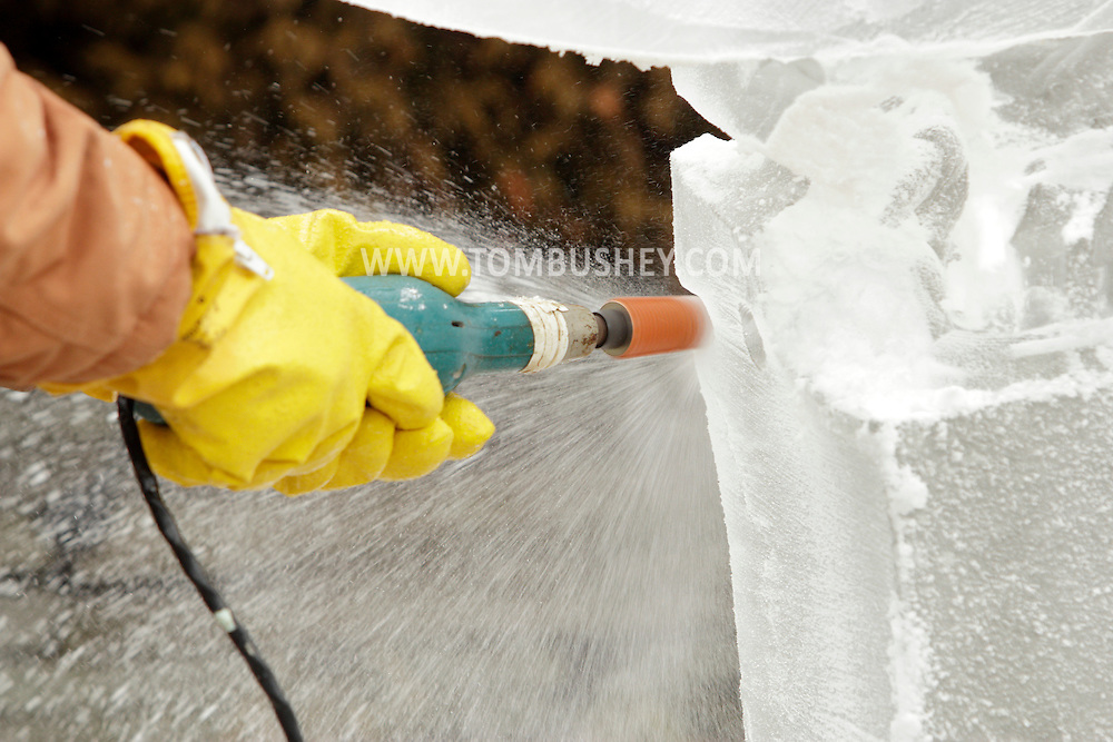 Wurtsboro, New York - Bill Bywater uses an electric tool to shape a block of ice during the ice carving competition at the Wurtsboro Winterfest on Feb. 11, 2012. ©Tom Bushey / The Image Works