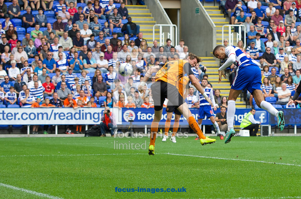 Michael Hector (15)of Reading scores the opening goal with a header despite pressure from Richard Stearman of Wolverhampton Wanderers during the Sky Bet Championship match at the Madejski Stadium, Reading<br /> Picture by Alan Stanford/Focus Images Ltd +44 7915 056117<br /> 28/09/2014