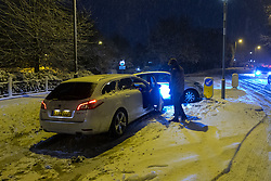 An accident involving three cars blocks one lane of the B519 in Hampstead as snowfall on higher ground in London creates treacherous driving conditions. Hampstead, London, February 01 2019.