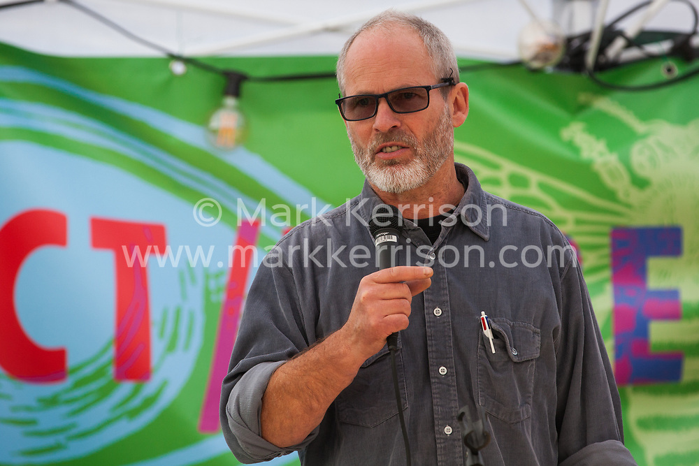 London, UK. 9 October, 2019. Duncan Law, founder member of Transition Town Brixton, addresses climate activists from Extinction Rebellion blockading Trafalgar Square on the third day of International Rebellion protests to demand a government declaration of a climate and ecological emergency, a commitment to halting biodiversity loss and net zero carbon emissions by 2025 and for the government to create and be led by the decisions of a Citizens' Assembly on climate and ecological justice.
