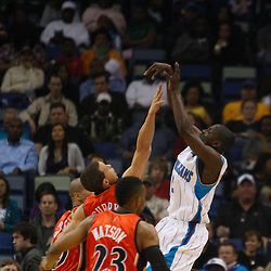 Mar 08, 2010; New Orleans, LA, USA; New Orleans Hornets guard Darren Collison (2) shoots over three Golden State Warriors defenders during the first half at the New Orleans Arena. Mandatory Credit: Derick E. Hingle-US PRESSWIRE