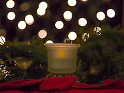Candle, holiday, christmas, bokah, lighted background, sparkles.