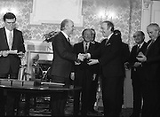 New Fianna Fáil Administration Sworn In.  (R52)..1987..10.03.1987..03.10.1987..10th March 1987..After their win in the recent general election the new Fianna Fáil government,under the leadershio of Charles Haughey, was sworn in and given their seals of offce at a ceremony in Áras an Uachtaráin today. The government received their seals from President Patrick Hillery...Photograph shows President Hillery presenting the seal of office to Michael O'Kennedy at the ceremony in the Arás