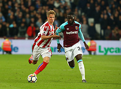 April 16, 2018 - London, England, United Kingdom - Stoke City's Moritz Bauer holds of West Ham United's Arthur Masuaku.during English Premier League match between West Ham United and Stoke City at London stadium, London, England on 16 April 2018. (Credit Image: © Kieran Galvin/NurPhoto via ZUMA Press)