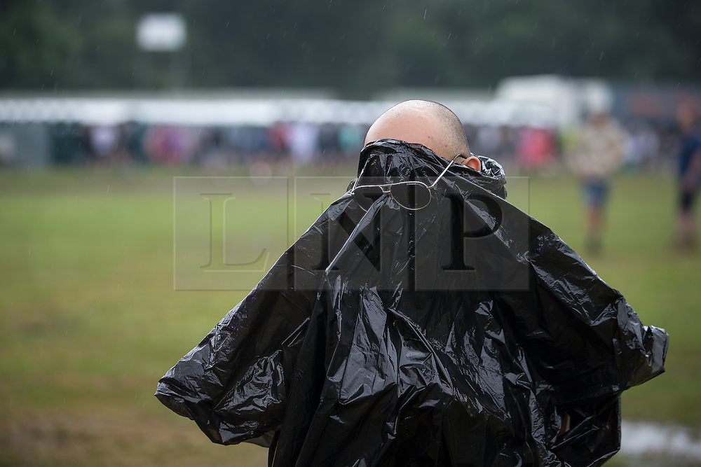 © Licensed to London News Pictures . 11/06/2016 . Manchester , UK . A man wearing a bin liner as a poncho at the Parklife music festival at Heaton Park in Manchester . Photo credit : Joel Goodman/LNP