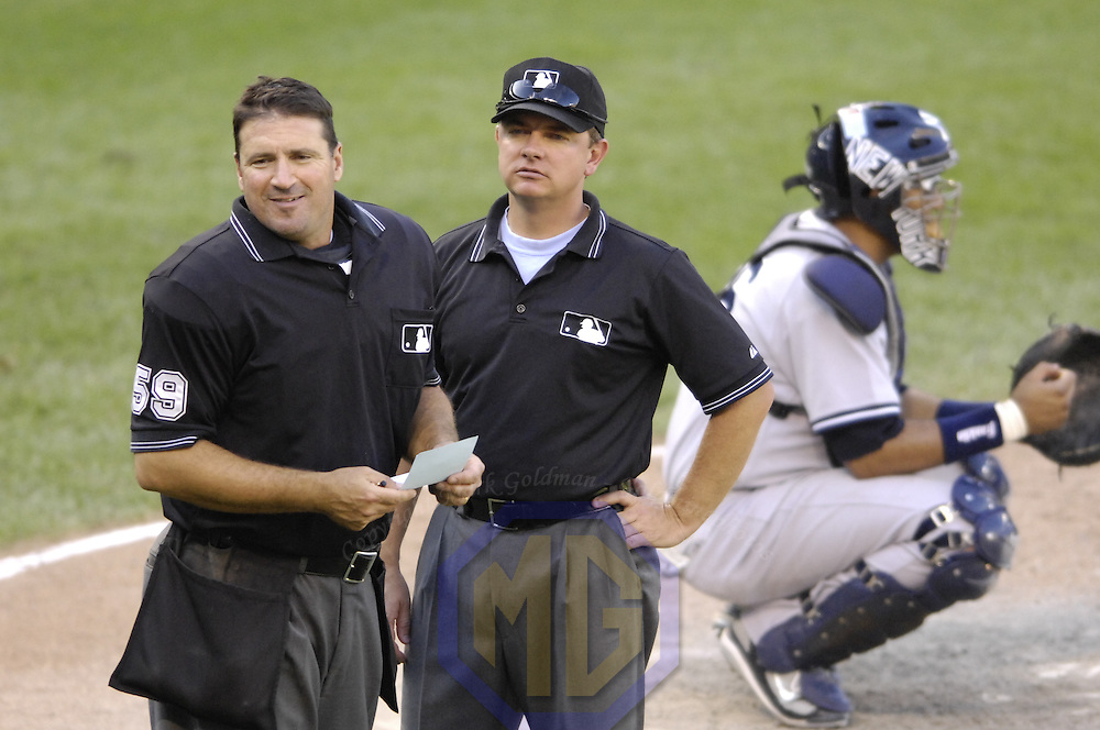 30 September 2007:  Home plate umpire Tony Randazzo (59) is checked by fellow umpire Greg Gibson (R) after being  hit by a foul ball during the game between the New York Yankees and the Baltimore Orioles.  The Yankees defeated the Orioles 10-4 to end the regular season at Camden Yards in Baltimore, MD.  ****For Editorial Use Only****