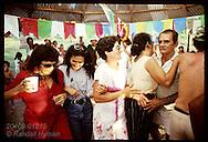 People dance together in pavilion at Festa Junina (June Fest) celebration on Carvalho ranch near Eirunepe, Brazil.