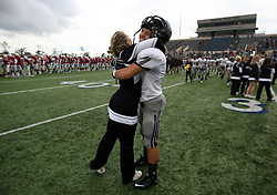 Pearland's Cody Rost (7) hugs cheerleader Nikki Eatadower after the Oilers' 35-14 victory over the Lamar Redskins in the 5A Division I Region III semifinal, Saturday, November 26, 2011 at Galena Park Stadium in Houston, TX.