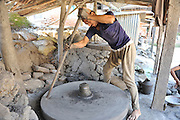 Asia, Nepal, Kathmandu, A potter and his turning wheel