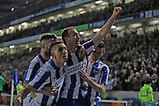 Brighton & Hove Albion centre forward Glenn Murray (17) scores a goal 1-0 and celebrates with Brighton & Hove Albion centre forward Sam Baldock (9) and Brighton & Hove Albion winger Anthony Knockaert (11) during the EFL Sky Bet Championship match between Brighton and Hove Albion and Leeds United at the American Express Community Stadium, Brighton and Hove, England on 9 December 2016.