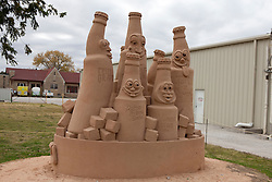Sand sculpture of soda bottles outside of Dr. Pepper Bottling Company plant, Dublin, Texas, United States of America
