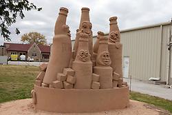 Sand sculpture of soda bottles outside of Dr. Pepper Bottling Company plant, Dublin, Texas, United States of America