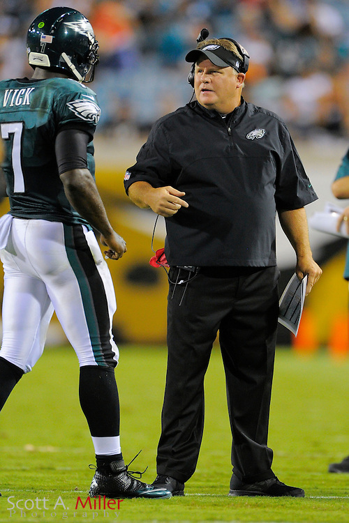 Philadelphia Eagles head coach Chip Kelly and quarterback Michael Vick (7) during a preseason NFL game against the Jacksonville Jaguars at EverBank Field on Aug. 24, 2013 in Jacksonville, Florida. The Eagles won 31-24.<br /> <br /> &copy;2013 Scott A. Miller