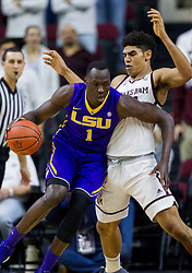 LSU forward Duop Reath (1) drives around Texas A&M center Tyler Davis (34) during the first half of an NCAA college basketball game Saturday, Jan. 6, 2018, in College Station, Texas. (AP Photo/Sam Craft)