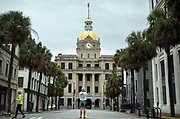 Savannah fine art photographer Dan Kaufman stops in the middle of nearly deserted downtown Savannah, Ga., Sunday, Sept., 10, 2017 to take a photo of City Hall  before winds from the outer bands of Hurricane Irma are forecast to impact the area.  (AP Photo/Stephen B. Morton)