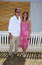 TOM RUTHERFORD and NAOMI FRANKS at the Veuve Clicquot sponsored Gold Cup Final or the British Open Polo Championship held at Cowdray Park, West Sussex on 17th July 2005.<br />