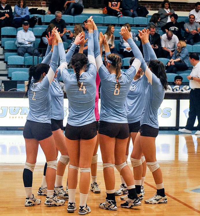 10/18/2013 - Cousens Gym, Tufts Medford campus - The team stretches before the volleyball home game where Tufts defeats Hamilton 25-12. Caroline Geiling / The Tufts Daily