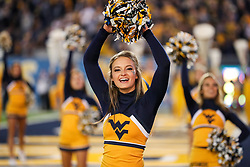 Nov 4, 2017; Morgantown, WV, USA; A West Virginia Mountaineers cheerleader performs during the fourth quarter against the Iowa State Cyclones at Milan Puskar Stadium. Mandatory Credit: Ben Queen-USA TODAY Sports