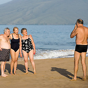 Two mature couples at Kamaole Beach Park in Maui taking pictures of each other