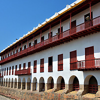 Naval Museum of the Caribbean in Old Town, Cartagena, Colombia<br /> This building with the 230 foot arcade of barred windows and red shutters was a Jesuit school when it was built in 1632. Latter it became a military barracks and then a hospital. Since 1992, it has housed the Museo Naval de Caribe. Inside you will find displays, exhibits and artifacts telling the story of Cartagena's long history with the sea. The Naval Museum's front door is located at Plaza de Santa Teresa.