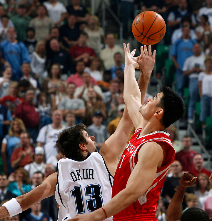 """The Utah Jazz's Mehmet Okur goes up for the opening """"tip off"""" with Yao Ming of  the Houston Rockets in game 4 of the first round of the playoffs at the Energy Solutions Arena in Salt Lake City, Utah Saturday, April 28, 2007.  August Miller/ Deseret Morning News"""