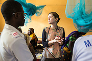 Dr Siobhan Neville gets advice from Dr Peter O'Reilly, during the daily rounds. The rounds are attended by all the medical staff who work on that ward, doctors, nurses and attendants. St Walburg's Hospital, Nyangao. Lindi Region, Tanzania.