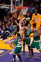 17 June 2010: Forward Pau Gasol of the Los Angeles Lakers shoots the ball while being triple teamed by the Boston Celtics during the first half of the Lakers 83-79 championship victory over the Celtics in Game 7 of the NBA Finals at the STAPLES Center in Los Angeles, CA.