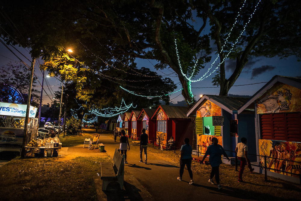 """PORT OF SPAIN, TRINIDAD - FEBRUARY 15, 2017: The sprawling Queen's Park Savannah is the heart of the city, with amateur cricketers playing one of the country's favorite sports on the park's green lawns on weekend afternoons, and food stalls serving up some of the best casual dining in town after dusk. Head for the cluster of white tents, bright lights and music and stroll through, picking up corn soup flavored with vinegar and studded with chunks of carrots and corn on the cob, pholourie (bread-like dumplings, lightly fried and served with a sweet dipping sauce), chicken feet and cow heels pickled with slices of cucumber (called """"souse""""), and finish with a bag of the sweet and savory """"chow"""": slices of peeled fruit, often under-ripe mango, salted and doused with a peppery garlic sauce that's amazingly moreish. Dinner for two, around 100TT. Vendors on the perimeter of the park will open a fresh coconut for 10TT.   PHOTO: Meridith Kohut for The New York Times"""
