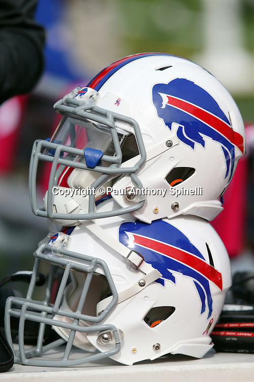 A pair of Buffalo Bills helmets are stacked atop each other during the 2015 NFL week 4 regular season football game against the New York Giants on Sunday, Oct. 4, 2015 in Orchard Park, N.Y. The Giants won the game 24-10. (©Paul Anthony Spinelli)