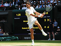 Tennis - 2019 Wimbledon Championships - Week Two, Friday (Day Eleven)<br /> <br /> Men's Singles, Semi-Final: Novak Djokovic (SRB) vs. Roberto Bautista Agut (ESP)<br /> <br /> Djokovic , on Centre Court.<br /> <br /> COLORSPORT/ANDREW COWIE
