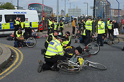 © Licensed to London News Pictures. 10/10/2019. London UK: Extinction Rebellion protesters block the access road to London City airport. Police are stopping protesters from shutting down the airport as their campaign enters its forth day , Photo credit: Steve Poston/LNP