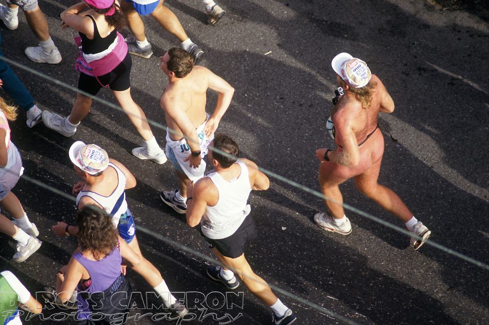 Unidentified naked man, right, follows the pack down the Hayes Street hill at the 81st running of the Bay to Breakers 12K race, Sunday, May 17, 1992 in San Francisco. (Photo by D. Ross Cameron)