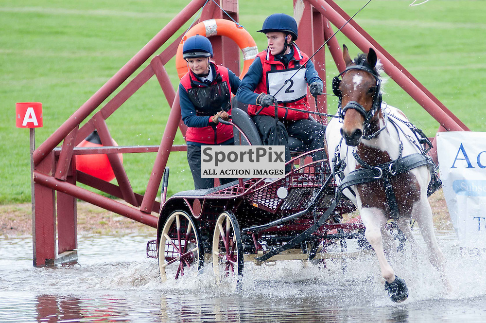 His Royal Highness, Prince Phillip, The Duke of Edinburgh, was attending the 2014 Hopetoun Horse Driving Trails. William Hendry in action in one of the water obstacles. Saturday, 24th May, 2014. (c) Wullie Marr | SportPix.org.uk