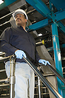 Man working in newspaper factory low angle