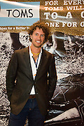Blake Mycoskie at the Clinton Global Initiative University Meeting 2009 in Austin Texas, February 14, 2009. Blake Mycoskie is the Founder and Chief Shoe Giver of TOMS Shoes. The Clinton Global Initiative University Meeting 2009 is a non-partisan catalyst for action, bringing together global leaders, students, university representative, non-profit organizations, charities, and business leaders to discuss challenges and devise innovative solutions.