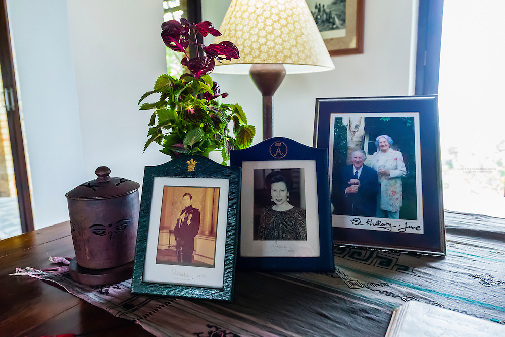 Portraits of Prince Charles and Princess Anne and Edmund Hillary, Tiger Mountain Pokhara Lodge, above the Pokhara Valley, Nepal.