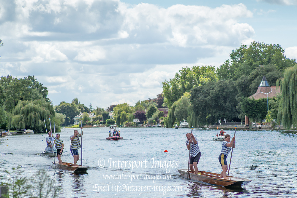 "Maidenhead, United Kingdom.  ""Mixed Doubles"", approaching the ""Finsh Line"". ""Thames Punting Club Regatta"", Bray Reach.<br />