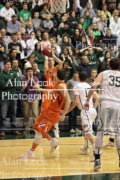 01 March 2014:  Caleb DeMoss is left all alone to shoot a three during an NCAA mens division 3 CCIW  Championship basketball game between the Wheaton Thunder and the Illinois Wesleyan Titans in Shirk Center, Bloomington IL