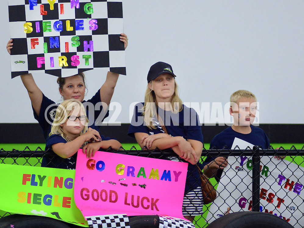 HORSHAM, PA - AUGUST 22: Family and friends of participant, Esther Siegle (NOT SHOWN) hold signs of encouragement in during the final heat of the Granny Grampy Grand Prix at Speed Raceway August 22, 2014 in Horsham, Pennsylvania. Grandparents competed in electric go cart races to win a trip for four to Florida for the grandchild that entered them into the contest, which was sponsored by radio station WMMR. (Photo by William Thomas Cain/Cain Images)