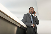 Businessman on Telephone at Counter