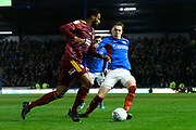 Ronan Curtis (11) of Portsmouth battles for possession with Janoi Donacien (2) of Ipswich Town during the EFL Sky Bet League 1 match between Portsmouth and Ipswich Town at Fratton Park, Portsmouth, England on 21 December 2019.