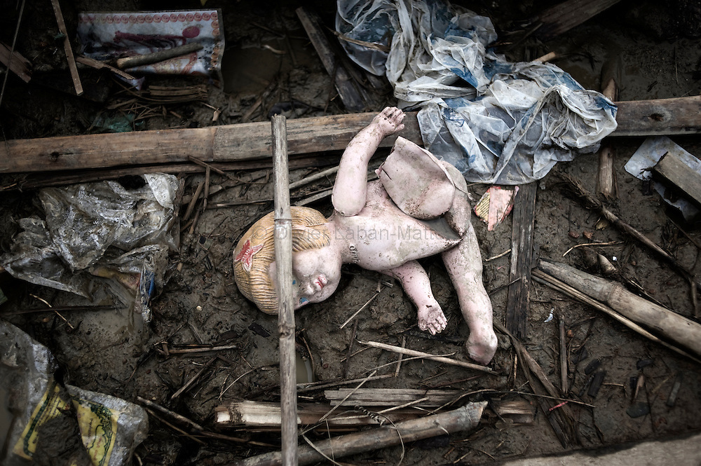 A doll is seen laying among wreckage from the cyclone Nargis in Kyauktan on the outskirts of Yangon on May 16, 2008. The Red Cross on May 16, 2008 launched an appeal for victims of the devastating cyclone in Myanmar and warned that delays in providing emergency aid would exacerbate an already dire situation.