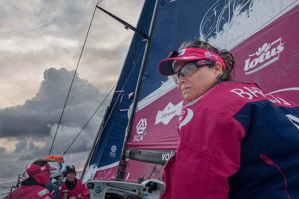 April 22, 2015. Leg 6 to Newport onboard Team SCA. Day 3. Sally Barkow looks over her shoulder back at the fleet in the early morning.
